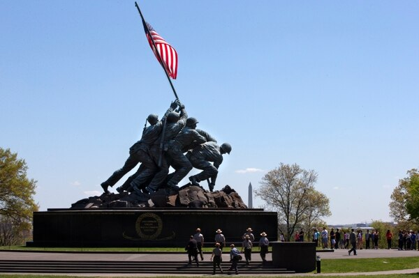 National Park Service rangers walk toward the U.S. Marine Corps War Memorial in Arlington, Va., Wednesday, April 29, 2015. (Jacquelyn Martin/AP)