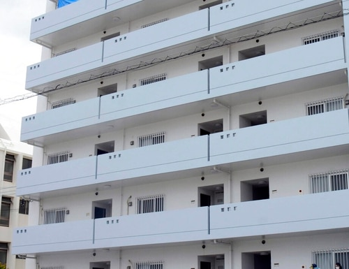 The apartment where a U.S. servicemen and a Japanese woman were found dead, in Chatan town on Okinawa on Saturday. The sailor fatally stabbed a Japanese woman and then killed himself , according to the Japanese Foreign Ministry, amid growing resentment about the presence of American troops in Japan's southwestern region. (Kyodo News via AP)