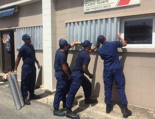 Coast Guard Aids to Navigation Team Puerto Rico personnel attach hurricane shutters on Monday in preparation for Tropical Storm Dorian. (Ricardo Castrodad/Coast Guard)