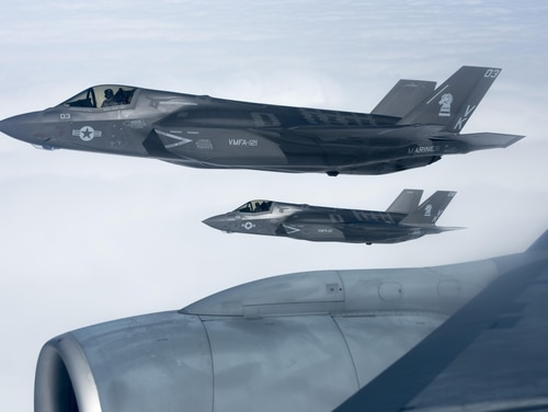 U.S. Marine Corps F-35B Lightning IIs from Marine Fighter Attack Squadron 121 fly in formation next to a U.S. Air Force KC-135 Stratotanker over Pacific waters. The F35-B is expected to deploy with two Marine expeditionary next year. (Senior Airman John Linzmeier/Air Force)