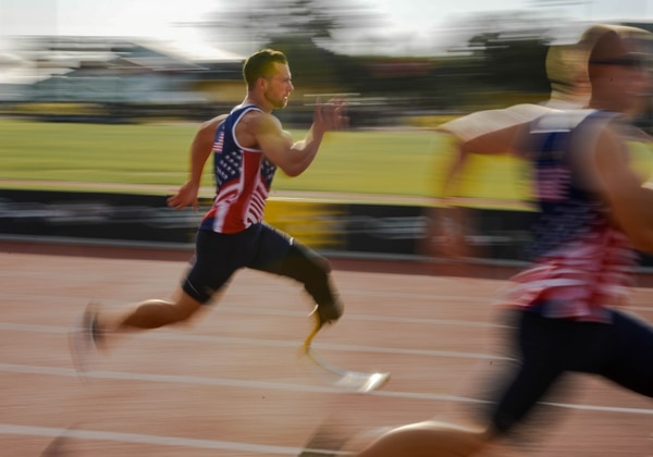 Tech. Sgt. Benjamin Seekell, of Team U.S., sprints during the male 100-meter track finals at the ESPN Wide World of Sports Complex in Orlando, Fla., May 10, 2016. The 2016 Invictus Games kicked off with a ceremony May 8, and 15 nations competed through May 12 in multiple adaptive sports events. (U.S. Air Force photo/Senior Master Sgt. Kevin Wallace)