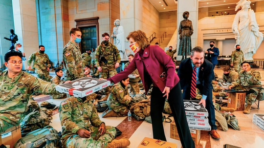 Members of Congress pass out pizza to National Guard members stationed within the Capitol. (Photo courtesy of We, The Pizza)