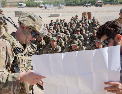 U.S. Army Sgt. 1st Class Christopher Davis of the 1st Security Force Assistance Brigade teaches a map-reading class to Afghan soldiers. (Sean Kimmons/U.S. Army)