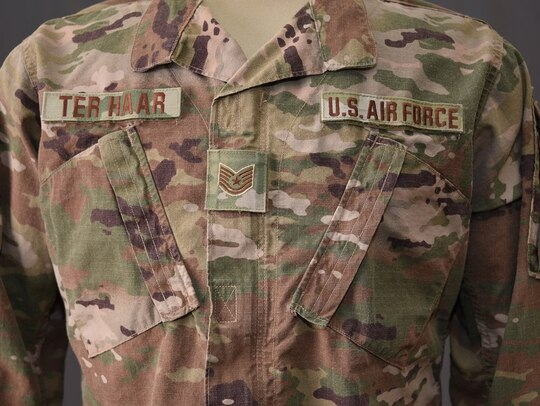 """This fall, the Operational Camouflage Pattern uniform will be the standard issue uniform of the U.S. Air Force and will feature Air Force specific """"Spice Brown"""" name tapes. The OCP has been issued to U.S. troops deploying overseas since 2012 and will have a """"hook and loop"""" rank displayed in the middle of the chest. (Tech. Sgt. Daniel Ter Haar/Air Force)"""
