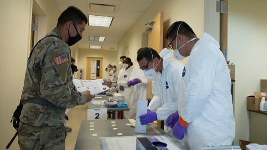 Soldiers attached to the Texas Army National Guard's 36th Infantry Division and 272th Engineer Company receive an COVID-19 antigen test at Camp Swift in Bastrop, Texas, on June 9, 2020. (Andrew Ryan Smith/Army)