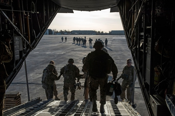 U.S. Army Soldiers from the 82nd Airborne Division leave a C-130H Hercules as they arrive in Iraq to support Operation Inherent Resolve, Feb. 6, 2015. About 1,000 Paratroopers from the 3rd Brigade Combat Team, 82nd Airborne Division deployed to advise and assist the mission in Iraq. During their rotation they will coach, teach and mentor Iraqi Security Forces to enable them to fight Da'ish. (U.S. Air Force photo by Senior Airman James Richardson/AFCENT/PAReviewed/Released)