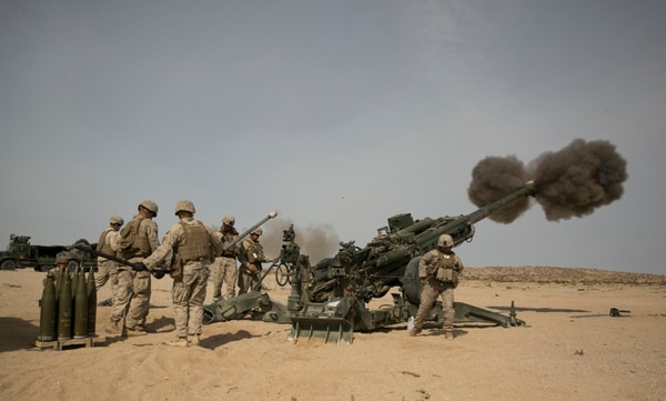 Cpl. Caroline Ortiz, a member of a gun crew with the Ground Combat Element Integrated Task Force, fires a howitzer during an artillery assessment at Marine Corps Air Ground Combat Center Twentynine Palms in Twentynine Palms, Calif., on Friday, April 10, 2015. In addition to artillery, the GCEITF is also evaluating the integration of female Marines into infantry and mechanized MOS's. (Mike Morones/Staff)