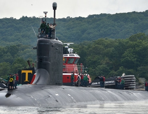 The submarine Virginia pulls into port. The Navy's latest Virginia-class submarine, the Block V, will be much larger and increase the missile capacity of the class, but one of the boats has been cut from the budget request. (U.S. Navy)