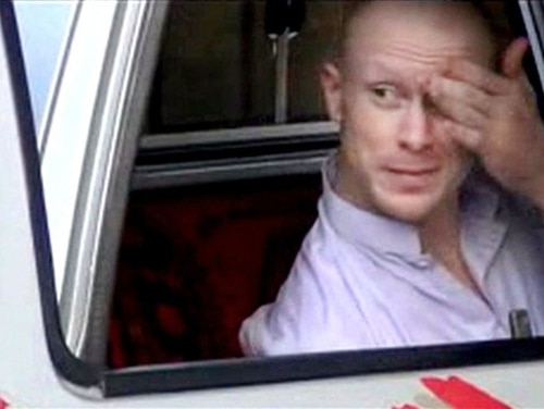 FILE - In this file image taken from video obtained from Voice Of Jihad Website, which has been authenticated based on its contents and other AP reporting, Sgt. Bowe Bergdahl, sits in a vehicle guarded by the Taliban in eastern Afghanistan. A one-year travel ban is expiring for five senior Taliban leaders held in U.S. detention at Guantanamo Bay until they were released last year in exchange for Bergdahl, who was held captive by the Taliban for nearly five years after he walked away from his Army post in Afghanistan. (AP Photo/Voice Of Jihad Website via AP video, File)