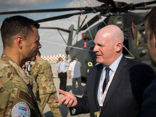 Assistant Secretary of State for Political-Military Affairs R. Clarke Cooper, right, converses with U.S. Air Force Col. Thad Middleton at the Dubai Airshow in the United Arab Emirates on Nov. 17, 2019. (Staff Sgt. Joseph Pick/U.S. Air Force)