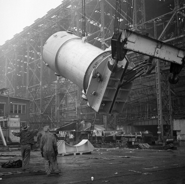 The nuclear reactor that will power the world's first atomic merchant ship is raised by a crane in preparation for placement in hull of the NS Savannah on May 13, 1959. The Eisenhower administration opted to build the NS Savannah instead of aerospace illustrator Frank Tinsley's airship design, an atomic-powered dirigible that might have served as Ike's atoms-for-peace demonstrator. (Bill Ingraham/AP)