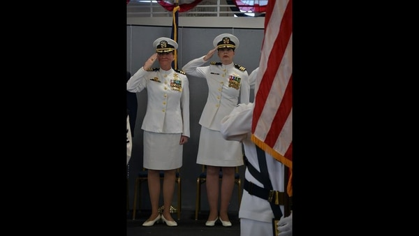 From left to right: Outgoing Helicopter Training Squadron Eight (HT-8) commanding officer Cmdr. Jessica Parker and incoming HT-8 commanding officer Cmdr. Lena Kaman salute colors during the national anthem on June 7, 2019, at Naval Air Station Whiting Field. It is the first time in known history that two women have led the squadron at the same time as commanding officer and executive officer. (Jamie Link/Navy)