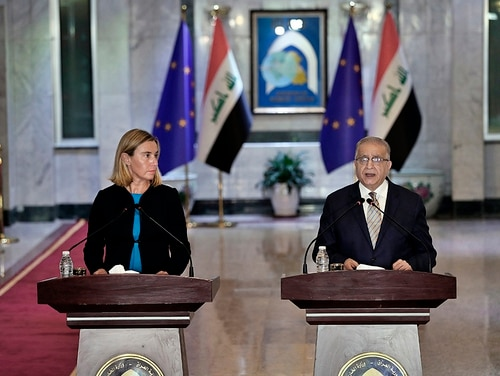 Iraqi Foreign Minister Mohamed Alhakim, right, holds a press conference with visiting European Union foreign policy chief Federica Mogherini after their meeting at the Ministry of Foreign Affairs in Baghdad, Iraq, Saturday, July 13, 2019. (Hadi Mizban/AP)