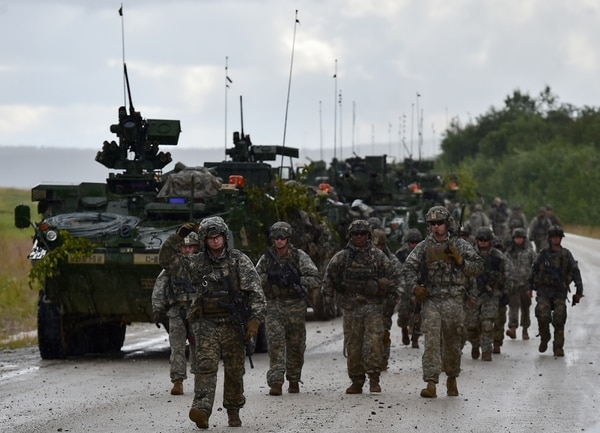 Soldiers assigned to 1st Battalion, 5th Infantry Regiment, 1st Stryker Brigade Combat Team, 25th Infantry Division, U.S. Army Alaska, walk in the rain in the Yukon Training Area near Fort Wainwright, Alaska, before a company live-five during the Arctic Anvil 2016 exercise, Saturday, July 23, 2016. Arctic Anvil is a joint, multinational exercise which includes forces from USARAK's 1st Stryker Brigade Combat Team, 25th Infantry Division and UATF, along with forces from the 196th Infantry Brigade's Joint Pacific Multinational Readiness Capability, the Iowa National Guard's 133rd Infantry Regiment and the 1st Battalion, Princess Patricia's Canadian Light Infantry. (U.S. Air Force photo/Justin Connaher)