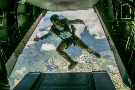 A member of the armed forces jumps out of an MV-22B Osprey during parachute training operations over Marine Corps Training Area Bellows, Hawaii, Aug. 13, 2019. (Lance Cpl. Jacob Wilson/Marine Corps)
