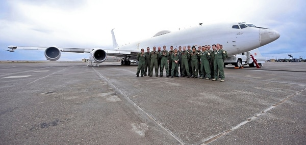 The joint Air Force and Navy crew of an E-6B Mercury Airborne Launch Control System aircraft pose for a picture on the tarmac of the Montana Air National Guard flight line in Great Falls, Mont., on April 5, 2016. (Airman Collin Schmidt/U.S. Air Force)