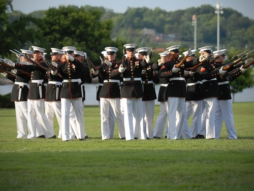 Members of the U.S. Marine Corps Silent Drill team perform at the U.S. Naval Academy for the Class of 2015. (Mass Communication Specialist 1st Class Chad Runge/Navy)