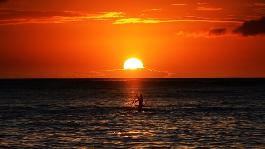 16 million veterans are now eligible for the discounts through DoD's American Forces Travel site. Here, the sunset seen from Waikiki beach in Honolulu. (JEWEL SAMAD/AFP/Getty Images)
