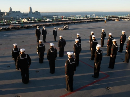 Sailors assigned to the aircraft carrier John C. Stennis stand for inspection earlier this month. (Navy)