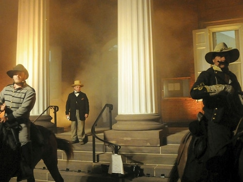 In this July 19, 2014, file photo, Civil War re-enactors simulate the 1864 burning of the Franklin County courthouse while marking the 150th anniversary of the Burning of Chambersburg in Chambersburg, Pa. (Ryan Blackwell/Public Opinion via AP)