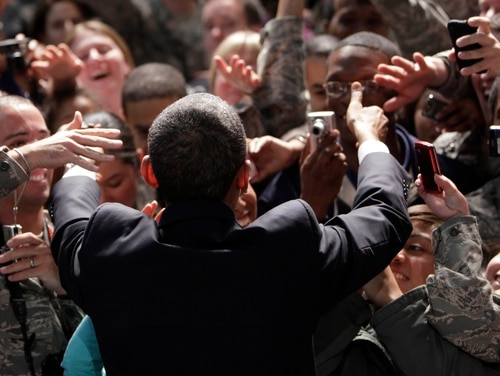 President Barack Obama greets members of the U.S. military during a rally with troops at Elmendorf Air Force Base in Anchorage, Alaska, Thursday, Nov. 12, 2009. (AP Photo/Pablo Martinez Monsivais)