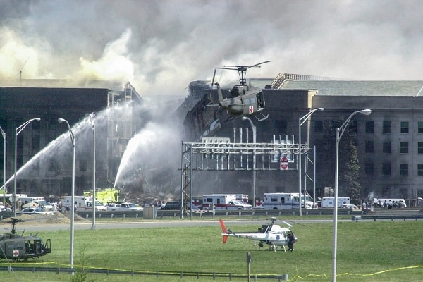 A Red Cross Army helicopter lands in front of the collision site at the Pentagon after the 9/11 attacks. (Army)