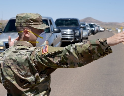 Arizona National Guard service members direct visitor check-in at a temporary COVID-19 testing site on the Navajo Nation May 19, 2020, in Tonalea, Ariz. (Tech. Sgt. Michael Matkin/Air Force)