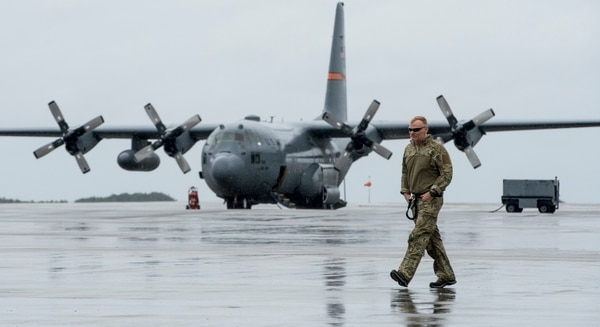 A member from the California National Guard makes his way to a C-130H Hercules from the Texas Air National Guard at Hurlburt Field, Florida, Sept. 11, 2017. Supplies, equipment and personnel were transported to the Florida Keys to help with the recovery efforts underway in the area. (Tech. Sgt. Nathan Lipscomb/Air Force)
