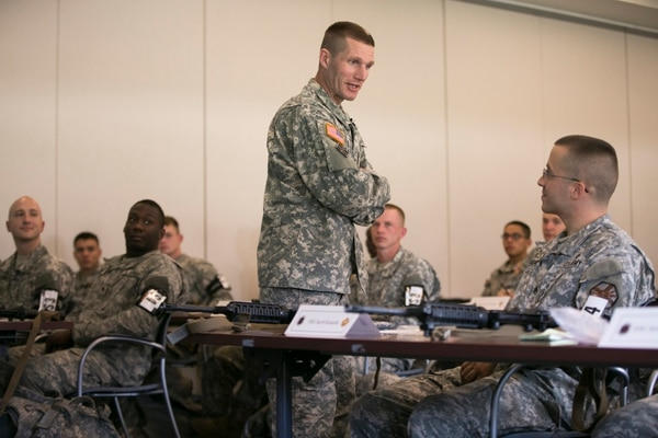 Sergeant Major of the Army Dan Dailey speaks with soldiers competing for the titles of NCO and Soldier of the Year in the Best Warrior Competition at Fort A.P. Hill in Bowling Green, Va., on Monday, October 5, 2015.