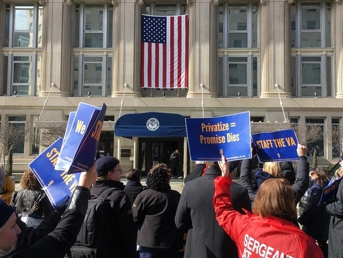 Members of the American Federation of Government Employees protest outside the Department of Veterans Affairs headquarters in Washington, D.C., on Feb. 13. (Leo Shane III/Staff)