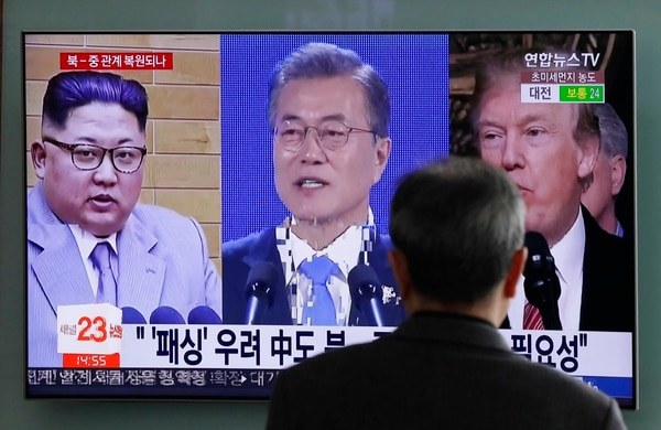 In this March 27, 2018, photo, a man watches a TV screen showing file footage of U.S. President Donald Trump, right, South Korean President Moon Jae-in, center, and North Korean leader Kim Jong Un, left, during a news program at the Seoul Railway Station in Seoul, South Korea. (Lee Jin-man/AP)