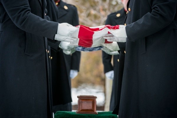 Marines from the Marine Barracks Washington fold the U.S. flag during military funeral honors. (Elizabeth Fraser/Army)