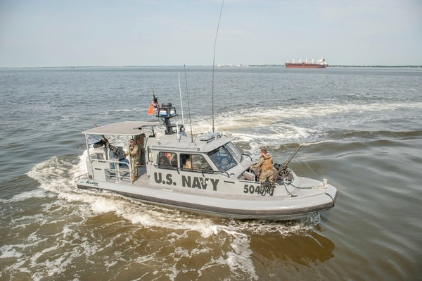 A 34-foot patrol boat from Coastal Riverine Group 2 makes a turn during operations in the ampton Roads region. (Mark D. Faram/Staff)