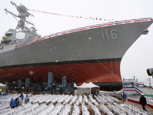 Snow falls on the future USS Thomas Hudner, a U.S. Navy destroyer named after Korean War veteran Thomas Hudner, during a christening ceremony in April 2017 at Bath Iron Works in Bath, Maine. The ship will be commissioned Saturday, Dec. 1, 2018 in Boston. (Mary Schwalm/Associated Press)