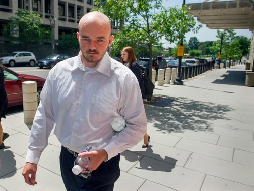 "FILE - In this June 11, 2014 file photo, former Blackwater Worldwide guard Nicholas Slatten leaves federal court in Washington. Slatten, found guilty for his role in a deadly Baghdad shooting has appealed his murder conviction. Slatten argued in an appeal filed Monday, Feb. 1, 2016, that the Justice Department's prosecution of him was ""vindictive"" and that prosecutors were ""determined to win at all costs."" (AP Photo/Cliff Owen, File)"