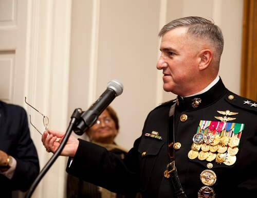 The Evening Parade host, Deputy Commandant for Programs and Resources Lt. Gen. Glenn M. Walters, right, gives an address during a parade reception at the Home of the Commandants in Washington, D.C., May 16, 2014. The Evening Parades are held every Friday night during the summer months. (U.S. Marine Corps photo by Cpl. Michael C. Guinto/Released)