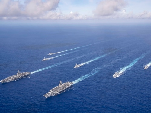 The Theodore Roosevelt and Nimitz carrier strike groups transit the Philippine Sea in June. The Pentagon is weighing a dramatic change to the composition of the U.S. fleet that could include in excess of 500 ships. (MCSN Dylan Lavin/U.S. Navy)