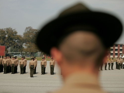 PARRIS ISLAND, SC - MARCH 08: A United States Marine Corps drill instructor watches recruits on the parade deck during boot camp March 8, 2007 at Parris Island, South Carolina. The Department of Defense has asked Congress to increase the size of the Marine Corps by 27,000 troops and the Army by 65,000 over the next five years. (Photo by Scott Olson/Getty Images)