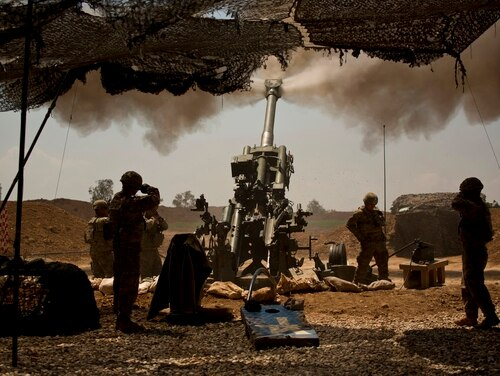 In this April 17, 2017, photo, U.S. soldiers from the 82nd Airborne Division fire artillery in support of Iraqi forces fighting Islamic State militants from their base east of Mosul. With operations against ISIS in Iraq largely over, the Pentagon will still not say how many troops are serving there. (Maya Alleruzzo/AP)