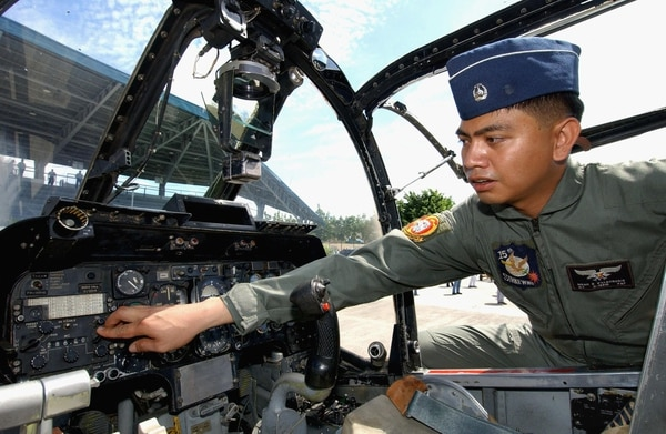 A Philippine Air Force pilot checks the controls of one of four OV-10