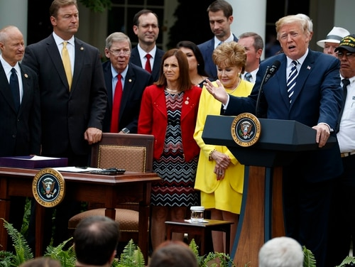 President Donald Trump speaks during a bill signing ceremony for the VA Mission Act in the Rose Garden of the White House on June 6, 2018. Rule making for the bill is expected to be a contentious fight in the months to come. (Evan Vucci/AP)