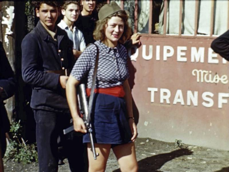 A French girl holding a weapon