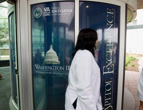 People walk part the entrance of the Washington D.C. VA Medical Center in June 2014. (Jose Luis Magana/AP)