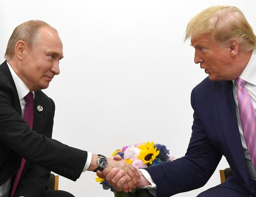 President Donald Trump, right, shakes hands with Russian President Vladimir Putin during a bilateral meeting on the sidelines of the G-20 summit in Osaka, Japan on June 28. (Susan Walsh/AP)