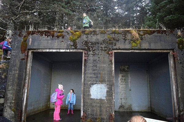 Peterson Elementary students explore an old WWII-era Army building at Fort Abercrombie State Park's Miller Point in Kodiak, Alaska. (Jack Barnwell/Kodiak Daily Mirror via AP)