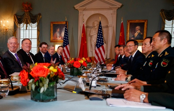 Secretary of Defense Jim Mattis, left, Secretary of State Mike Pompeo, second from left, Chinese Politburo Member Yang Jiechi, third from right, and Chinese State Councilor and Defense Minister General Wei Fenghe, second from right, meet at the State Department in Washington on Frida. (Carolyn Kaster/AP)