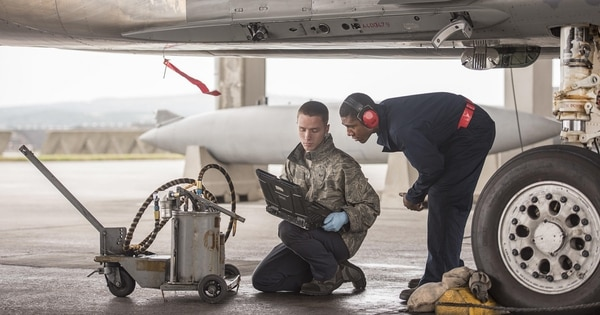 "Crew chiefs maintain an F-15 Eagle at Kadena Air Base, Japan. Ensuring airmen can deploy is about ""fairness,"" officials say. (Senior Airman Omari Bernard/Air Force)"