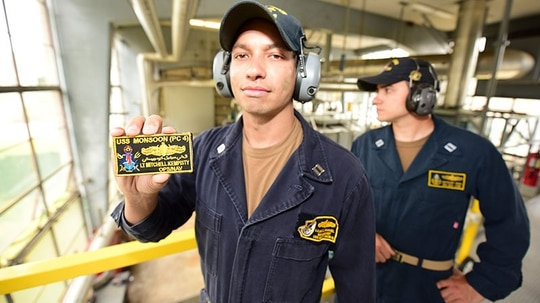 Lt. Mitchell Kempisty has patented an invention that helps keep coverall nametags from getting curled and wrinkly. (Naval Postgraduate School)