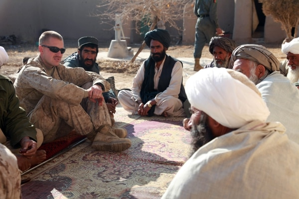 U.S. Marine Corps Capt. Jason C. Brezler, with 3rd Battalion, 4th Marine Regiment, meets with Afghan leaders in Now Zad, Afghanistan, on Dec.15, 2009. Marines meet with town elders to discuss the reconstruction process. (Cpl. Albert F. Hunt/ Marine Corps)