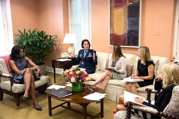 First Lady Michelle Obama and Dr. Jill Biden, right, listen to Col. Nicole Malachowski, Executive Director, Joining Forces, during a Joining Forces Department planning meeting in the First Lady's East Wing Office of the White House, Sept. 16, 2015. (Official White House Photo by Amanda Lucidon) This official White House photograph is being made available only for publication by news organizations and/or for personal use printing by the subject(s) of the photograph. The photograph may not be manipulated in any way and may not be used in commercial or political materials, advertisements, emails, products, promotions that in any way suggests approval or endorsement of the President, the First Family, or the White House.